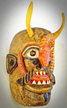 South American Mask ($225) carved wood and marbles for the eyes.