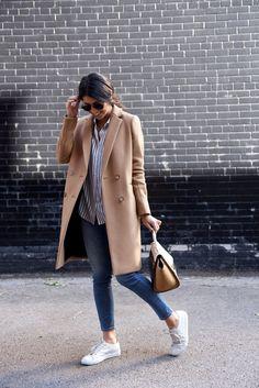 Coat: Sezane, Blouse: The Kooples, Jeans: Acne, Sneakers: Common Projects, Bag: Celine, Bracelet: Jenny Bird.