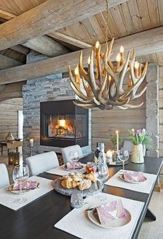 Beautiful stone fireplace and antler chandelier in this cabin style home. Cabin Style Homes, Log Cabin Homes, Log Home Interiors, Rustic Interiors, Cosy Interior, Home Interior Design, Mountain House Decor, Dream House Plans, Beautiful Interiors