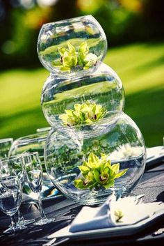 centerpiece: 3 fishbowls, 3 different sizes, with a flower in the middle