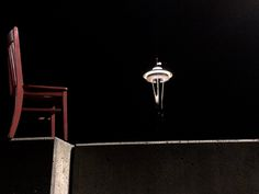 The Red Chair remembers on 9/11.  The Space Needle and the flag at half mast #redchairtravels #travelwa #remember911 #spaceneedle