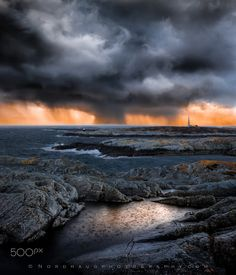 The perfect storm - From bright, sunny skies to hailstorm within a matter of a few minutes. But conditions like that must be expected by the rugged shores of the north atlantic...Island of Frøya in Norway. Photography by Dag Ole Nordhaug