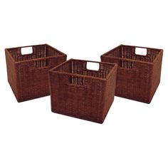 Add a touch of natural style to your bookcase or entryway console with these woven, wicker baskets, perfect for stowing remotes, throws, and out-the-door ess...