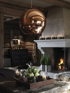 Cosy log fire and the room is dominated by superb copper light fitting