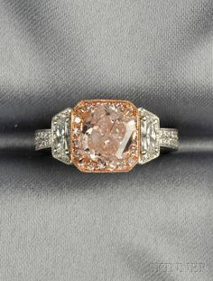 Platinum, 18kt Rose Gold, Colored Diamond, and Diamond Ring, prong-set with a light pink square-cut diamond weighing 3.00 cts., framed by pink diamond and diamond melee, flanked by fancy-cut diamonds, millegrain accents