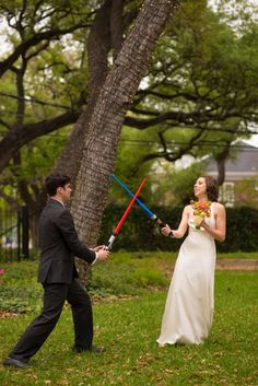 A star wars light saber battle in the park with the bride and groom | A Practical Wedding