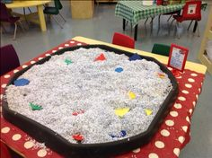Older Nursery - a shape hunt. Sort through the shredded paper to find and identify the 2D shapes.