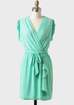 Deidra+Sash+Belt+Dress+In+Mint 39.99 at shopruche.com. Perfected with a flattering surplice neckline, this mint-hued chiffon dress features a faux wrap design and short slit sleeves. Finished with a removable sash belt and an elastic waistband for a defined silhouette. Fully lined skirt.100��0Polyester, Made...