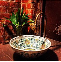 Hand painted bowl as sink in bathroom