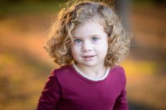 Natural posing, child photography, golden light, curly hair