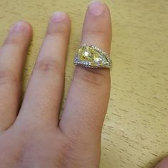 Yellow stone ring Brand new, never used unique yellow shaped stone Jewelry Rings