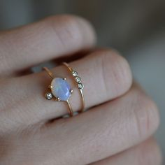 -solid 14kt gold -natural ethiopian opal -1.3mm diamond (VS/1 clarity) A truly gorgeous and eye catching ring, that will have you smitten in no time!! Available in all sizes (including half sizes, so