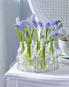 Love the idea of small bottles in the chicken wire tray.  Perfect for tiny flowers like grape hyacinths.