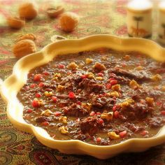 خورش فسنجون Khoresh-e Fesenjoon is one of the most delicious Persian dishes. Biting into a tender piece of a well cooked sweet and sour c...