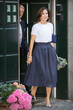 Crown Princess Mary of Denmark opted for a chic white blouse teamed with a navy polka dot skirt. She finished off her sophisticated ensemble with a pair of snakeskin pumps, adding pearl earrings and a matching bracelet to pull the whole look together, as she opened the new Centre of Grief in the Danish capital.