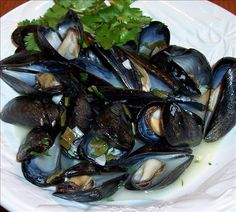 "Mussels in White Wine & Garlic: ""Everyone knows if you want reastaurant quality mussels, you come to my house thanks to this recipe! These are marvelous. I use a cheap dry white cooking wine and they are still to die for."" -Abby, Sarah & Eli's Mom"
