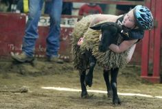 Mutton Bustin' by Andrea Melendes, desmoinesregister.com: Mackenzie Davis of Des Moines held onto her sheep the longest Friday during the mutton busting event at the Iowa State Fair. Children 8 years old and younger had the chance at a gentler version of stock riding by seeing how long they could ride a sheep. #Iowa State_Fair #Sheep_Riding #Andrea_Melendez #desmoinesregister