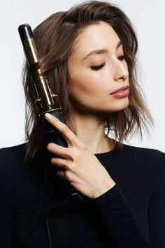 """Holding a 1½"""" curling iron vertically, loosely wrap large sections of hair around the barrel. Make s... - Jeff Allen"""