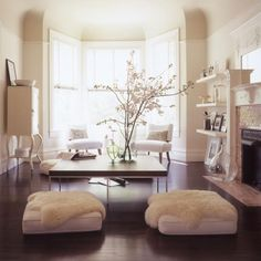 <3 the sheepskin-covered ottomans... great dog beds
