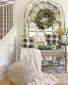 Is this not the cutest idea? I love the use of the old window in the back, the bench, the cozy blanket, the cute seat, and the bench. #farmhouse