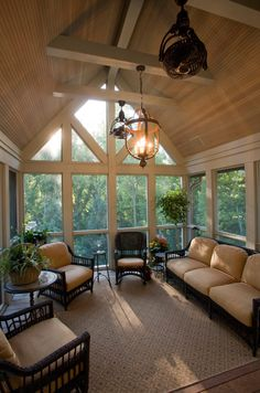 Tall gable roof for screened-in porch.