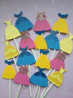 12 Disney Princess Dress Cupcake Toppers,Aurora,Snow White,Cinderella,Sleeping Beauty,Baby Shower,Princesses,Birthday Party,Disney Princess. $10.00, via Etsy.