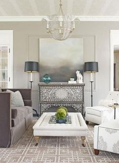 Chic Gray Sunroom Chic grays tempered by comfy neutrals and eye-catching patterns fill this sunroom designed by Gerri Wiley. Sophisticated fabrics on the tailored furniture mix to create a clean and luxurious ambience. Positioned against the wall under a landscape oil painting, a 19th-century Syrian wedding chest boasts mother-of-pearl inlays for inverted contrast.