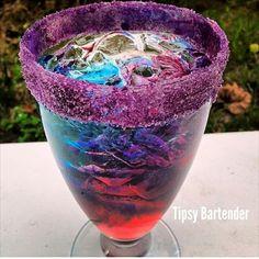 Grateful Dead...1 oz Vodka, 1 oz Gin, 1 oz Tequila Silver, 1 oz White Rum, 1 oz Triple Sec, 3 oz Lemon Lime Soda. Shake, strain in hurricane glass. Add 1 oz Blue Curaçao on one side, 1 oz Raspberry Liqueur on other.