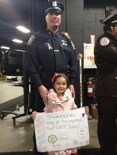 """4/21/13 Ceremony for """"Shirts Off Their Backs"""" postgame at home against the FL Panthers. A young fan with her sign in the line of 1st responders."""