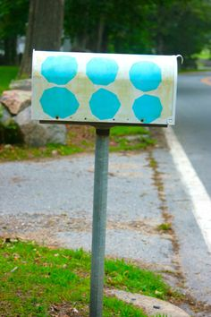 Turquoise polka dots on a mail box...