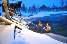 """Ice swimming. A smoke sauna by the """"Sauna-achitect"""" Risto Vuolle-Apiala. Kiilopää, Finnish Lapland."""