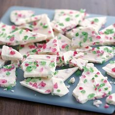 Crunchy Christmas Candy Bark is a sweet Christmas treat you can make at home in minutes! You've got to love the seasonal sparkle and festive colors that red and green Wilton Sugar Gems bring to classic candy bark made with Wilton Candy Melts candy.