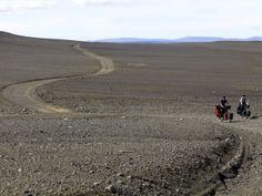 """Photograph by Brooks Walker    Cyclists tackle the Sprengisandur track across the island's highland interior. The jeep road, open in summer, follows the main volcanic rift zone.    Read more about Iceland in """"Life Atop a Cauldron"""" in the April 2011 issue of National Geographic Traveler."""