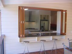 Byfold windows kitchen. Small bench runs along the exterior to give room for light to flood downstairs?
