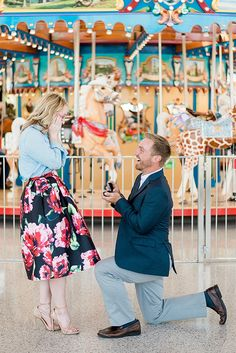 This carousel proposal is so cute! She had no idea this photoshoot would turn into a real proposal, and it's the most beautiful surprise.