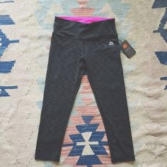 RBX yoga pants Dark heather grey with pink lining. Brand new with tags. Have never been worn. Mid calf length RBX Pants
