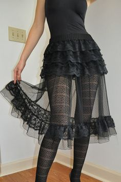 Handmade full, sexy, romantic skirt constructed from tulle and lace in black color.  This skirt is designed to set 5 ruffles lace snuggly around your hips before flaring out, super full, gathered layers. On the bottom is black lace ruffle trimmed to and sexy look. The elastic waistband is comfortable for your waist and no show.  The skirt makes your day-to-day wears modern and elegant.  You will find that there are so many different ways to wear this skirt...over leggings, over mini skirts, o... Lace Ruffle, Ruffle Skirt, Ruffle Trim, Ruffles, Tulle, Under Dress, Emo Fashion, Sexy, Mini Skirts