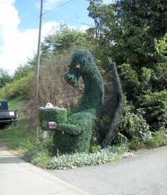 Topiary dragon mailbox - if only he could be trained to incinerate the junk mail!