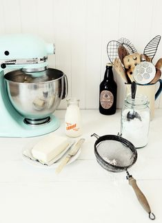 I love this kitcheny look, the duck egg blue, the old school kitchen implements and the bottle of guinness!