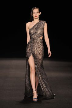 Monique Lhuillier F 15: Exquisite! I like the lame one shoulder gown with thigh high slit and side cutout. Gorgeous & Glam!