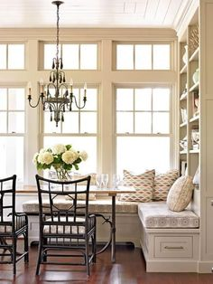 Kitchen banquette: A built-in storage wall elevates this traditional-style banquette from breakfast nook to multi-purpose corner. More ideas for banquettes: http://www.midwestliving.com/homes/decorating-ideas/6-ideas-for-kitchen-banquettes/?page=1