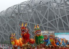 People practice dragon dance during the rehearsal of celebrating Beijing's bid for 2022 Winter Olympics at the Bird Nest.