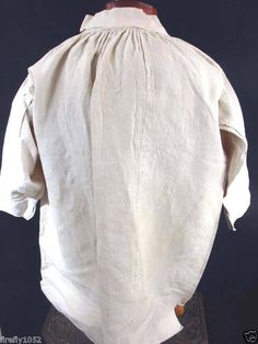 A VERY RARE EXCEPTIONAL QUALITY ANTIQUE FRENCH GEORGIAN PERIOD 1714-1830 MEN'S THICK HEAVY FLAX LINEN SHIRT. THIS ITEM IS FROM A LARGE COLLECTION IN PARIS, FRANCE. THE HAND MADE SHIRT HAS MANY UNIQUE DETAILS WITH TIGHT PLEATING ALONG THE NECKLINE AND BACK SHOULDER SEAM AND A V SHAPE SEWN INTO THE SIDE SHOUDERS. THE CONDITION IS EXCELLENT FOR THIS PERIOD. THE 30 INCH SLEEVES (FROM CUFF TO CENTER COLLAR ALONG THE OUTER EDGE) ARE 3/4 LENGTH WITH A 54 INCH CHEST, 34 INCH LENGT