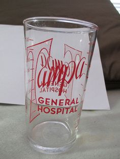 MEASURING GLASS - TAMPA GENERAL HOSPITAL,  FLORIDA FL 1-8 OUNCES - RED LETTERS