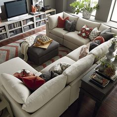 U Shaped Couch with Discount Sale for Living Room Furniture: U Shaped Couch With Striped Tribal Pattern Rugs And Fabric Ottoman Table Plus Costco Tv Stand Ideas