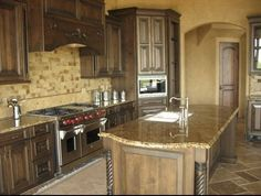 tuscan kitchen - wood beams = important element in tuscan style