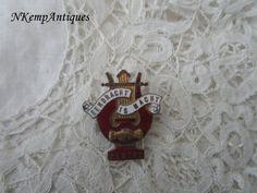Old enamel badge/button by Nkempantiques on Etsy