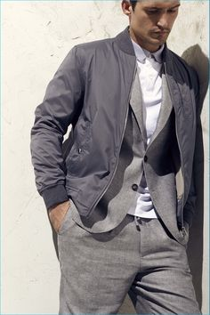 Cool greys are brought together with a nylon bomber jacket signaling the juxtaposition of casual and formal.