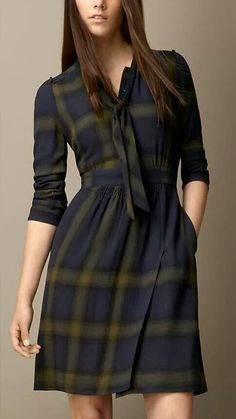 CHECK WOOL BLEND TIE-DETAIL DRESS - A check wool blend dress with a feminine tie-neck. Gentle gathers and ruching offset the defined waist, while the skirt is finished with thigh-split detail. The shoulders and back yoke are framed by gathered detailing. Modern Hijab Fashion, Plaid Fashion, Look Fashion, 80s Fashion, Fashion Boots, Winter Fashion, Kurti Neck Designs, Blouse Designs, Plus Size Shirt Dress