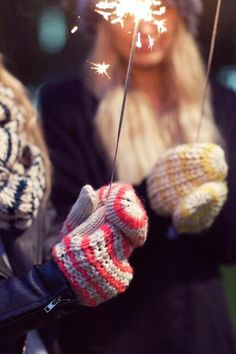 Holiday fireworks outdoors fireworks winter girls mittens holidays christmas
